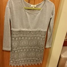 New Gray Crochet Front Long Shirt! New Shirt with crochet style on the front.  Such a cute shirt! I bought this new shirt,  but my arms were too big for this.  I was so bummed! This will look cute with leggings! Hopefully it will find a Happy New owner! Tops Tees - Long Sleeve