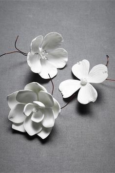 "Porcelain Bloom - fresh blooms are captured in fine porcelain. Tuck into centerpieces, aisle garlands, onto cakes or around napkins. Choice of dogwood, cherry blossom, or magnolia. Handmade porcelain & copper wire fastener. Dogwood: 4 petals; Cherry: 5 petals; Magnolia: 13 petals; all 4""L, 3""W. Imported. (10.00 each)"