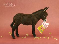 This little brown donkey was created by handin a miniature scale of 1:12 (one inch = twelve inches) using polymer clay over an armature of foil & wire. It stands at a wee bit over 3...