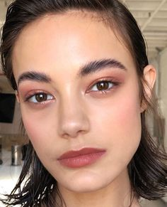 Brown, natural makeup and wet-style hair