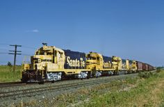 https://flic.kr/p/Bxdh5E   Almost There   Four rebuilt Santa Fe GP7's have almost completed the climb out of the Trinity River Valley on the north side of Ft Worth and are proceeding up the main at Saginaw.  The date is Jun 21, 1990 and you can bet the crew is none too happy about having the only non-air conditioned unit in the consist on the point.   It was rare to see one of the round cab units down here at this point in time, as they were mostly assigned to yard service at Corwith.