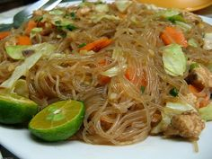 Pancit, or pansit, is a quick-cooked noodle dish that is one of the quintessential meals of Filipino cuisine. All kinds are available, and pancit is as popular at street stands as it is at family gatherings. The most common variety is pancit bihon, with r Filipino Noodles, Filipino Pancit, Lumpia Recipe Filipino, Filipino Soup Recipes, Pancit Bihon Recipe Panlasang Pinoy, Mie Noodles, Pancit Noodles, Asian Noodles, Comida Filipina