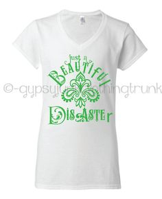 This beautiful disaster henna shirt is super soft and hand designed with this Beautiful Disaster Quote graphic design and paisley print. This handmade gypsy v-neck t-shirt is a super soft cotton blend white style next level brand v-neck. This white gypsy shirt is soft t-shirt is designed right here in my smoke free studio. If you love that boho and gypsy spirit you will love this white beautiful disaster v neck shirt.    This is an excellent cotton blend fitted womens v neck t shirt. True to…