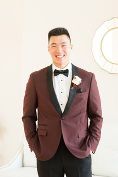 http://Groom%20wearing%20burgundy%20attire%20for%20Raleigh%20Wedding