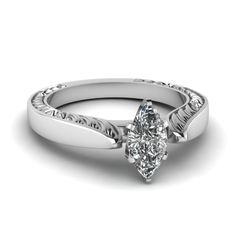 Recurred Flake #Ring features a prong set center stone, which is highlighted by a unique recurred flake design carved on the either sides of the #ring band.  http://jangmijewelry.com/