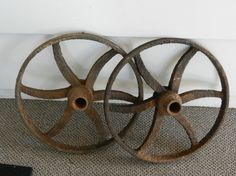 A great statement piece! These antique cast iron wheels are in great, rusted condition. These make a great conversation piece for your home