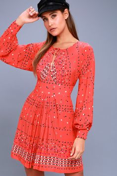 Feel put together in an instant when you slip into the Free People Coryn Coral Orange Print Long Sleeve Dress! Lightweight woven fabric, in a coral orange, black, white, purple, and yellow abstract print, creates a tying, V-neckline, and billowing long sleeves with button cuffs. Banded waist tops a flattering fit and flare skirt. Back cutout with top buttons and hidden zipper/clasp.