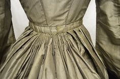 Pleating used to achieve fullness at the back of a skirt. Collection: Royal Pump Room/Harrogate Museum.
