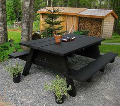 chalkboard picnic table {I'd pick a different color, but this would be fun as a mini kids table outside!}
