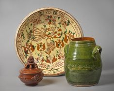 Brandywine River Museum 'Seeing Red: Southeastern Pennsylvania Earthenware from Winterthur' displays 50 treasures from the famous collection formed by Henry Francis du Pont. Shown are a fancy covered bowl, 1780-1830; a decorated dish with inscription and the date 1787, attributed to George Hubener of Montgomery County; and a green-glazed jar reading 'Sarah Worthman 1806.' Photo Credit: Jim Schneck.