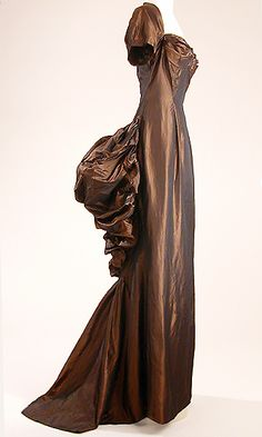 Castillo Changeante Brown Silk Taffeta Evening Gown   American, circa 1947   Bodice with pleated sweetheart neckline, separate bra, short sleeves, fitted through the waist self ruched bustle back with trained skirt