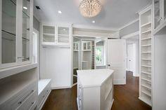 Traditional Closet with Custom Mirrors, Diamond White, Quartz, Window seat, Built-in bookshelf, flush light, Hardwood floors