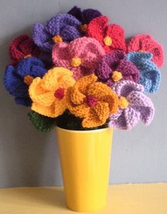Pinwheel Flowers-This pattern is available as a free Ravelry download. These are simple garter stitch flowers, knitted in one piece, which can be used as brooches or decorations. A pattern for stalks and leaves is also included, should you want to knit a bouquet.