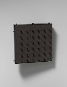 Brooch by Thomas Gentille. 2007. Steel, mica, and bronze.