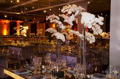Planned, Designed & Produced by www.swankproductions.com Modern chic wedding decor. Mirrored tables. White orchid centerpiece.