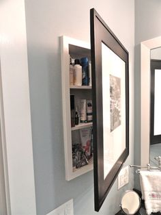 Contemporary Bathroom by J. Carsten Remodeling  [take care that the wood screws attach to an area that supports the picture and that screws do not go through other side of frame]