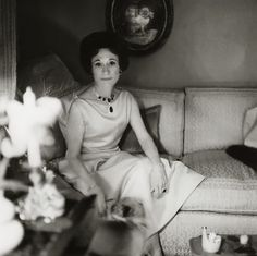 The Duchess of Windsor sitting on a couch in her Paris home, wearing a diamond and sapphire necklace from Vogue magazine 1964.