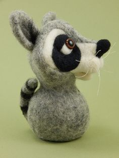 A needle felted raccoon finger puppet from Terese Cato.