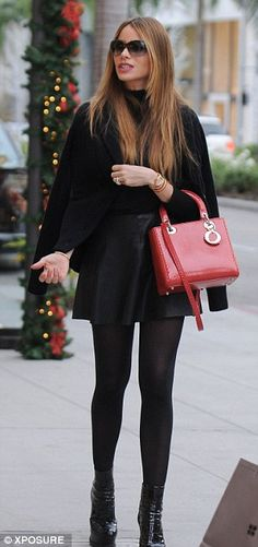 Youthful: Sofia Vergara - leather skirt, black tights and platform boots