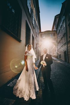 Our latest fantastic couple from Russia  - O+V  beautiful Castle Konopiste wedding & a Prague portrait session. Pictured are the couple holding hands as the sun flares beautifully behind them during their late afternoon Prague portrait session. For many couples from Russia, traveling to Prague for an intimate wedding is becoming very popular. Wedding photography by Kurt Vinion.
