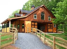 This simple barn kit was turned into a masterpiece in Raleigh, NC. DC Building built this beautiful wood barn with custom breezeway doors, and four custom stall fronts. This post and beam barn adds charm to the owners already lovely property.