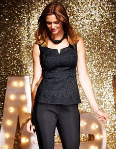 Here is a neckline to try. Jacquard Top in Black by Pepperberry - Nipping you in at the waist, this flattering jacquard top looks great when teamed with tailored black trousers. Side seam zip.