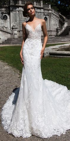Captivating mermaid silhouette wedding gown Sheylin is made of classy stretch satin, delicate gauze and beautiful lace. The corset is made in romantic linen style with open back and tender straps. The long trail is beautifully lace decorated.
