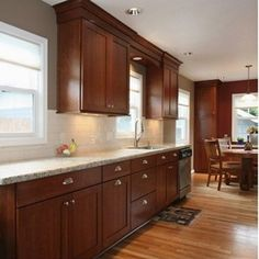 cherry kitchen cabinets with granite countertops cherry cabinets and white subway PQNLZWT Cherry Wood Kitchen Cabinets, Cherry Wood Kitchens, Refacing Kitchen Cabinets, Brown Cabinets, Kitchen Redo, Kitchen Countertops, Kitchen Remodel, Shaker Cabinets, Countertop Backsplash