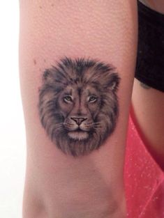 Awesome lion head tattoo on inner arm.