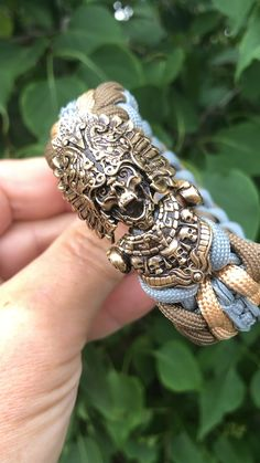One of our most rare and elaborate bracelets, The Aztek Priest featured a handmade bronze clasp, delicately depicting a fanged Aztek Priest adorned with skulls Paracord Braids, Paracord Bracelets, Bracelets For Men, Jewelry For Men, Knot Bracelets, Survival Bracelets, Fashion Bracelets, Bracelet Crafts, Jewelry Crafts