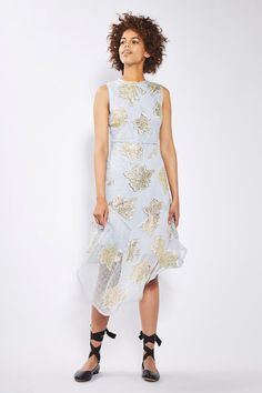 Make a style statement with our hanky hem line midi dress. Embellished with striking gold floral details, the uneven hem and fresh white fabric make this thirties inspired dress a chic choice for special occasions this season.