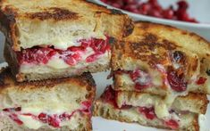 Boozy roasted cranberries and gooey brie make this mouthwatering grilled cheese sandwich a quick favorite. What better way to use up all that leftover homemade cranberry sauce?