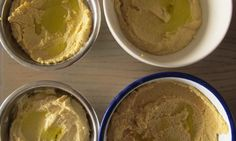 Claudia Roden's hummus recipe with (clockwise from top left), tinned, dried, jarred and skinned tinned chickpeas.  Photograph: Felicity Cloake for the Guardian