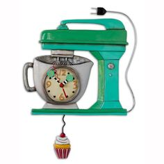 Time to make the cupcakes! Topped off with a generous swirl of frosting and a cherry on top. A whimsical Vintage Green Mixer Clock with swinging vanilla cupcake pendulum will sweeten your day! A fun,