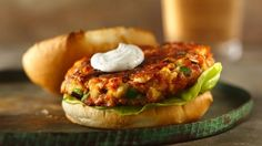 Cream and dill sauce provides a simple addition to a hearty salmon burger that's ready in 30 minutes - great for dinner. Perfect if you love seafood.
