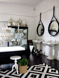 Interior design inspiration photos by 47 Park Avenue. Black Floorboards, Painted Floorboards, Painted Floors, Bathroom Chandelier, Hanging Chandelier, Black White Bathrooms, Black Tub, South Shore Decorating, Eclectic Bathroom