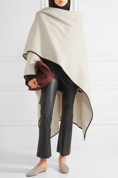 THE ROW Dusana suede-trimmed merino wool and cashmere-blend cape  $4,450.00 https://www.net-a-porter.com/product/801395