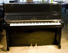 A 1995, Bechstein Studio 120 upright piano with a black case and polyester finish at Besbrode Pianos