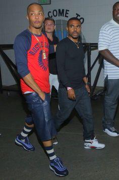 T.I. rocks a red and blue Hustle Gang shirt