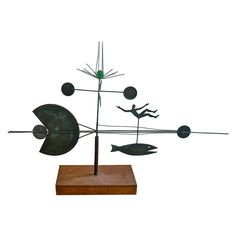 """WHIMSICAL SCULPTURE by BARNEY REID - measures 22"""" by 32"""" by 6""""."""