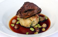Slow cooked chump of lamb, fried colcannon cake, pea and baby onion jus