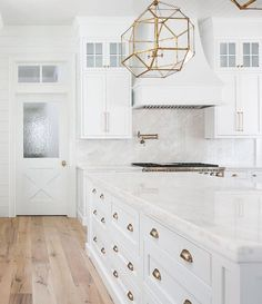Barcello cream marble. Barcello cream marble and backsplash behind wolf stove is a full slab of barcello cream. Barcello cream marble Built by Artisan Signature Homes. Interior Design by Gretchen Black from Greyhouse Design