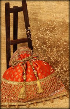 RD 1051- Parijaat Parijaat- stunning potlis in orange colour. Vibrant and fragrant like parijaat flowers                    Price: Rs. 2490
