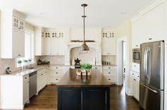 Cabinet color similar to BM Cloud White CC-40 Wall color is BM Monroe Bisque HC-26 3x6 travertine tiles