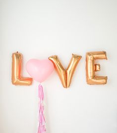 Love is definitely in the air with our LOVE Balloon Set.  Tassel balloon includes: - One (1) of each 36 inch mylar balloon in L,V,E- One (1) 36 inch heart balloon in pink- Approx. 5  feet (60 ) strand of tassels*balloon ships deflated and will require helium at your local party store**once balloon has been inflated simply tie the strand of tassels to the balloon.*** This item is handmade in Vancouver Canada and will ship in 1-2 weeks.