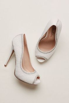 """LOVE!  Classically chic with a pop of sparkle!  High heel peep toe stilettos feature stunning pearl and crystal accents.  Heel height: 4 3/4"""". Platform: 1/2"""".  Fully lined.  Imported."""