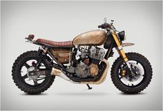 Built to survive: Yes, this is the actual Honda Nighthawk ridden by Daryl Dixon in the latest episode of The Walking Dead. Actor Norman Reedus already has a Classified Moto bike in his garage, so builder John Ryland got the shoulder-tap. And he discovered Honda Nighthawk, Honda Cb750, Yamaha Yzf R6, Cb Cafe Racer, Cafe Racers, Moto Scrambler, Daryl Dixon Motorcycle, Motorcycle Bike, Motorcycle Wiring