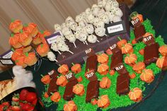 Halloween Party food and snacks - Graveyard; Brownies, mummies, colored coconut and pumpkin cupcakes.