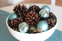 blue Christmas - pine cones and blue bulbs...exactly what I am planning to do for centerpieces!