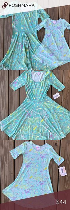 Lularoe Mommy and Me dresses Nicole (size small). beautiful dress! Great for twirling and twinning your mini-me!! Smoke free home. ***listing is for women's dress only*** LuLaRoe Dresses Midi